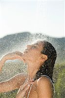 shower - Mid-adult woman showering outdoors Stock Photo - Premium Royalty-Freenull, Code: 632-05991893