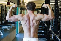 Barechested man flexing muscles Stock Photo - Premium Royalty-Freenull, Code: 632-05991948