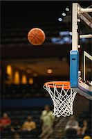 Basketball in midair above basketball hoop Stock Photo - Premium Royalty-Freenull, Code: 632-05992101