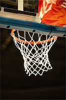 Basketball hoop, low angle view Stock Photo - Premium Royalty-Freenull, Code: 632-05992270