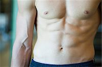 Muscular barechested man, mid section Stock Photo - Premium Royalty-Freenull, Code: 632-05992296