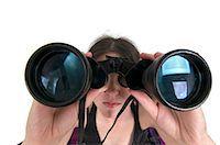 forward - Woman looks through a binoculars facing camera wide angle view Stock Photo - Premium Royalty-Freenull, Code: 679-05992447