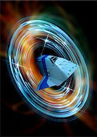 spaceship - Time travelling spacecraft. Conceptual computer artwork of a spacecraft travelling through a wormhole. Stock Photo - Premium Royalty-Freenull, Code: 679-05992727