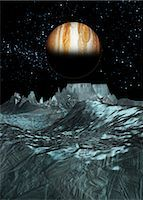 space - Jupiter from Europa. Computer artwork of a view towards Jupiter across the surface of Europa. Stock Photo - Premium Royalty-Freenull, Code: 679-05992808