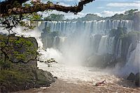 people in argentina - An inflatable boat takes visitors into white water at the bottom of one of the spectacular Iguazu Falls of the Iguazu National Park, a World Heritage Site. Argentina Stock Photo - Premium Rights-Managednull, Code: 862-05996711
