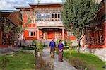 Friendly staff at the Ugyen Phendeyling Hotel in Paro. The hotel has a wonderful view of Tiger's Nest Monastery, high up on an opposite cliff face. Stock Photo - Premium Rights-Managed, Artist: AWL Images, Code: 862-05996901
