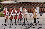 Young men attending the masked dancing at Trashi Chhoe Dzong, a monastery now also housing the secretariat, the throne room and offices of the King. Stock Photo - Premium Rights-Managed, Artist: AWL Images, Code: 862-05996916