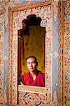 Young monk looking through one of the beautiful carved window frames at Tango Monastery. Stock Photo - Premium Rights-Managed, Artist: AWL Images, Code: 862-05996934