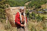 Elderly lady carrying a large basket in the Tang Valley. Stock Photo - Premium Rights-Managed, Artist: AWL Images, Code: 862-05996994