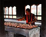 Lighting butter lamps at the beautiful 7th century Jampey Lhakhang, near Jakar in the Chokhor Valley. Stock Photo - Premium Rights-Managed, Artist: AWL Images, Code: 862-05997003