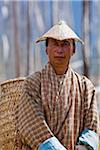A farmer carrying a large bamboo basket and wearing a beautifully made bamboo hat in Ura. Stock Photo - Premium Rights-Managed, Artist: AWL Images, Code: 862-05997016
