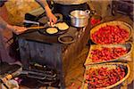 Preparing pancakes in a homestay kitchen in Ura village. Stock Photo - Premium Rights-Managed, Artist: AWL Images, Code: 862-05997022