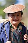 A Bhutanese lady wearing a traditional bamboo hat in Chumey Valley. Stock Photo - Premium Rights-Managed, Artist: AWL Images, Code: 862-05997025