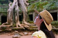 Cambodia, Angkor, Siem Reap, Ta Prohm Temple, Woman exploring Stock Photo - Premium Rights-Managednull, Code: 862-05997265
