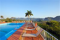 palm - The Caribbean, West Indies, Cuba, Vinales Valley, Unesco World Heritage Site, swimming pool at Hotel Los Jazmines Stock Photo - Premium Rights-Managednull, Code: 862-05997411