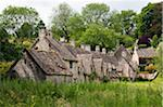 Famous Arlington Row of the 17th century stone cottages with steeply pitched roofs, Bibury, Cotswolds, Gloucestershire, UK Stock Photo - Premium Rights-Managed, Artist: AWL Images, Code: 862-05997501