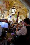 Musicians playing musical instruments in a restaurant, Hofbrauhaus, Munich, Bavaria, Germany. Stock Photo - Premium Rights-Managed, Artist: AWL Images, Code: 862-05997802