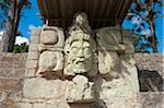 Central America, Honduras, Copan Ruins, Mayan archeological site, Copan Ruins, Unesco World Heritage site; carved face statue Stock Photo - Premi