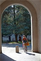 Italy, Tuscany, Lucca. Woman cycling through one of the numerous gates leading to the old city Stock Photo - Premium Rights-Managednull, Code: 862-05997957