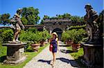 Italy, Tuscany, Lucca. A tourist walking in the gardens of villa Pfanner. Stock Photo - Premium Rights-Managed, Artist: AWL Images, Code: 862-05998009