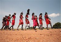 Maasai warriors perform a welcome dance at a lodge in the Masai Mara, Kenya. Stock Photo - Premium Rights-Managednull, Code: 862-05998384