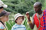 Children learning about traditional plant uses from a Maasai guide, Masai Mara, Kenya. Stock Photo - Premium Rights-Managed, Artist: AWL Images, Code: 862-05998387