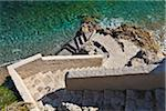 Steps down to a small beach near La Condamine, Pointe de la Poudriere, Monaco. Stock Photo - Premium Rights-Managed, Artist: AWL Images, Code: 862-05998612