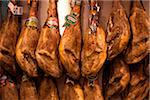 Spain, Andalusia, Seville; Jamon Serrano (Serrano Ham) hanging in a shop Stock Photo - Premium Rights-Managed, Artist: AWL Images, Code: 862-05999188