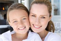 Close up of mother and daughters faces Stock Photo - Premium Royalty-Freenull, Code: 649-06000364