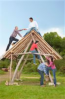 People climbing log hut outdoors Stock Photo - Premium Royalty-Freenull, Code: 649-06000599