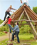People building log hut together Stock Photo - Premium Royalty-Freenull, Code: 649-06000601