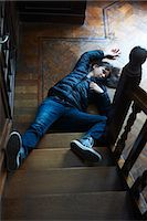 people falling - Teenage boy laying at foot of stairs Stock Photo - Premium Royalty-Freenull, Code: 649-06000732