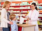 Pharmacist filling prescription in store Stock Photo - Premium Royalty-Free, Artist: Blend Images, Code: 649-06001310