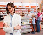 Smiling pharmacist standing in store Stock Photo - Premium Royalty-Free, Artist: Siephoto, Code: 649-06001312