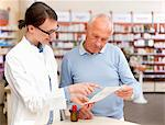 Pharmacist talking to patient in store Stock Photo - Premium Royalty-Free, Artist: Blend Images, Code: 649-06001321