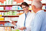 Pharmacist talking to patient in store Stock Photo - Premium Royalty-Free, Artist: Blend Images, Code: 649-06001322