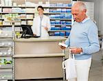 Man picking up prescription at pharmacy Stock Photo - Premium Royalty-Free, Artist: Blend Images, Code: 649-06001324