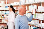 Customer browsing on drugstore shelves Stock Photo - Premium Royalty-Free, Artist: Siephoto, Code: 649-06001327