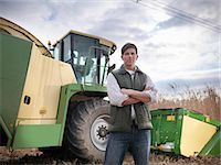 Farmer with tractor in elephant grass Stock Photo - Premium Royalty-Freenull, Code: 649-06001456