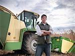 Farmer with tractor in elephant grass Stock Photo - Premium Royalty-Free, Artist: Aflo Relax, Code: 649-06001456