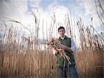 Farmer holding bunch of elephant grass Stock Photo - Premium Royalty-Free, Artist: Aflo Relax, Code: 649-06001460