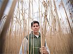 Farmer holding bunch of elephant grass Stock Photo - Premium Royalty-Free, Artist: Aflo Relax, Code: 649-06001465