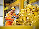 Apprentice engineer at work in factory Stock Photo - Premium Royalty-Free, Artist: Blend Images, Code: 649-06001474