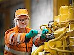 Apprentice engineer at work in factory Stock Photo - Premium Royalty-Free, Artist: Lloyd Sutton, Code: 649-06001477
