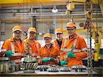 Engineer teaching apprentices in factory Stock Photo - Premium Royalty-Free, Artist: CulturaRM, Code: 649-06001486