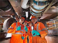 Engineer teaching apprentices in factory Stock Photo - Premium Royalty-Freenull, Code: 649-06001499