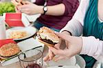 Couple eating fast food together Stock Photo - Premium Royalty-Free, Artist: Blend Images, Code: 649-06001606