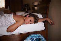 Teenage boy relaxing in bed Stock Photo - Premium Royalty-Freenull, Code: 649-06001709