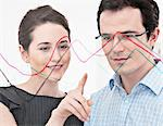 Businesswoman pointing to graph Stock Photo - Premium Royalty-Free, Artist: Ikon Images, Code: 649-06001918