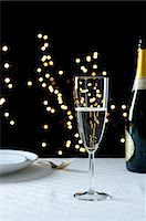 Champagne on a table Stock Photo - Premium Royalty-Freenull, Code: 614-06002066